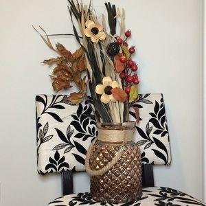 Decorative rose gold pot with flower arrangement